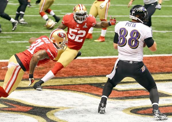 Ravens tight end Dennis Pitta (88) hauls in a touchdown catch against the 49ers' Donte Whitner and Patrick Willis (52) in the second quarter Sunday.