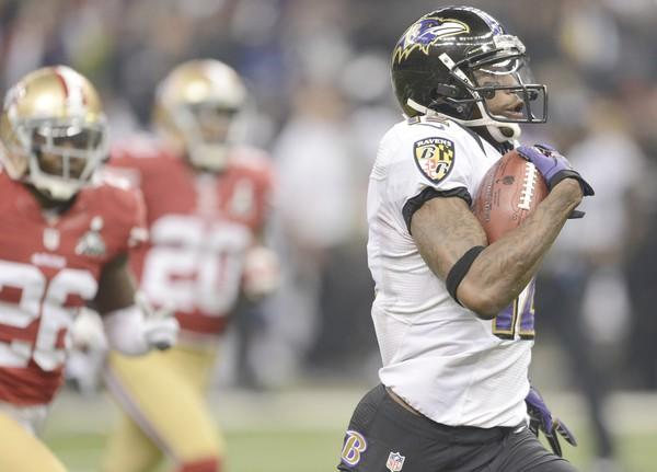 Ravens receiver Jacoby Jones breaks past 49ers defenders on the way to a record 108-yard kickoff return to open the second half Sunday.