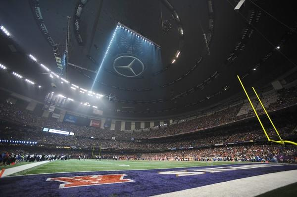 A bank of lights illuminates part of the Superdome field as officials wait for power to be restored to the stadium following a surge Sunday.