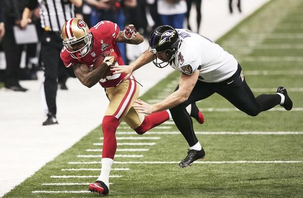 49ers receiver Tedd Ginn Jr. returns a punt 32 yards deep into Ravens territory in the third quarter Sunday. He's knocked out of bounds by Baltimore punter Sam Koch.