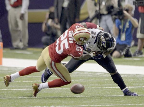Ravens running back Ray Rice fumbles as he's hit by 49ers defensive back Tarell Brown in the third quarter Sunday.