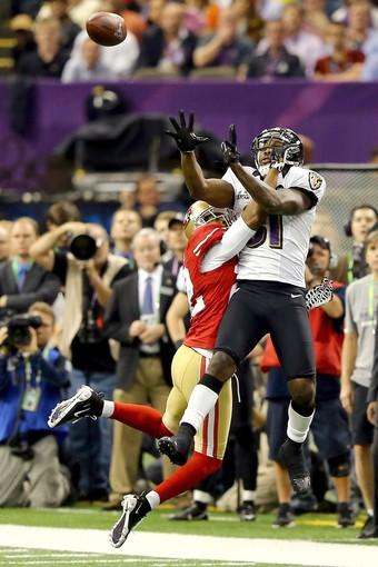 Ravens receiver Anquan Boldin makes a catch against 49ers defensive back Carlos Rogers in the fourth quarter to keep a scoring drive alive Sunday.