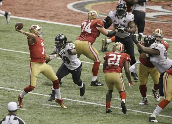 49ers quarterback Colin Kaepernick throws under pressure from Ravens linebacker Dannel Ellerbe on the decisive fourth-down play in the final minutes Sunday.