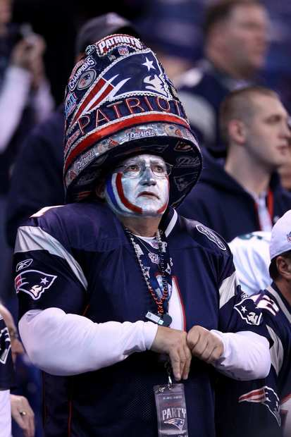A Patriots fan watches the teams warm up at Lucas Oil Stadium before Super Bowl XLVI on Sunday in Indianapolis.