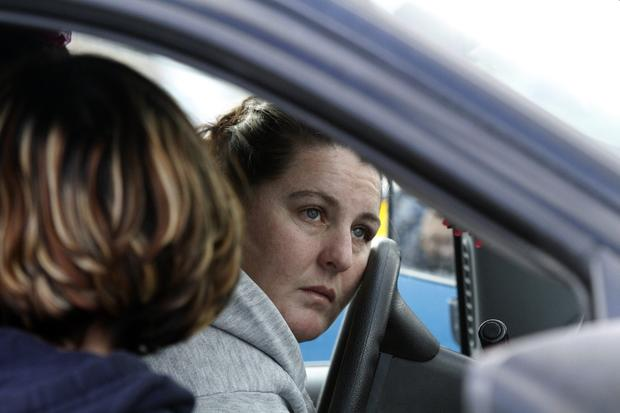 Danielle Overton, 33, waits for her daughter, who was stuck inside Taft Union High School in Kern County after a shooting by a student in a classroom.