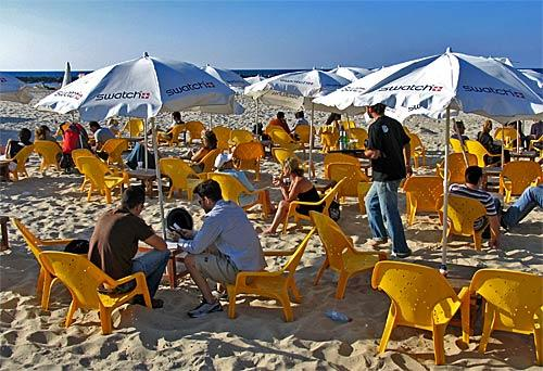 Beach goers soak up the sun in Tel Aviv along the Mediterranean Sea.