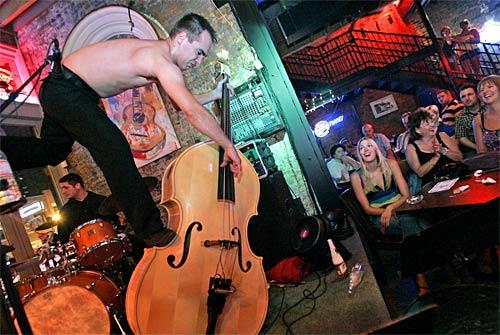 Who knew bass playing could be so visual? Sweet Joe Fick's upright is more than a prop as the Dempseys rock Rippy's Bar in Nashville. The fans ate up the extreme rockabilly sound, howling and clapping for the energetic threesome, especially Flick's acrobatic skills on the bass.