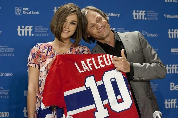 "Viggo Mortensen, right, and Keira Knightley hold up a Canadian hockey jersey at the ""Dangerous Method"" press day."