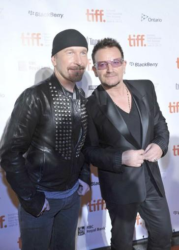 "The Edge and Bono of U2 attend the opening of ""From the Sky Down,"" the documentary about the band and its time recording 1991's ""Achtung Baby."""