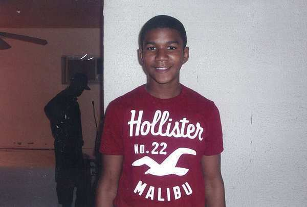 "Trayvon Martin, seen in an undated photo, was  <a href=""http://www.latimes.com/news/nation/nationnow/la-na-nn-florida-teen-neighborhood-watch-20120319,0,7016674.story"">killed by neighborhood watch volunteer George Zimmerman</a> on Feb. 26 while walking through a gated community in Sanford, Fla. Martin was wearing a hooded sweatshirt and carrying a cellphone, a bag of Skittles and an iced tea. 