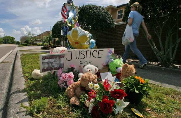 A makeshift memorial outside the gated community where Trayvon Martin was shot to death was still holding up when this photo was taken on March 20, but it gradually deteriorated. The items were moved to a local museum.