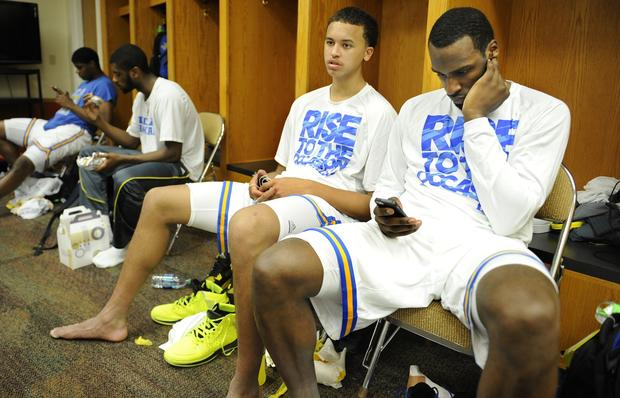 UCLA freshmen guards Kyle Anderson, left, and Shabazz Muhammad sit in the locker room after an 83-63 loss to Minnesota in the second round of the NCAA tournament on Friday night in Austin, Texas.