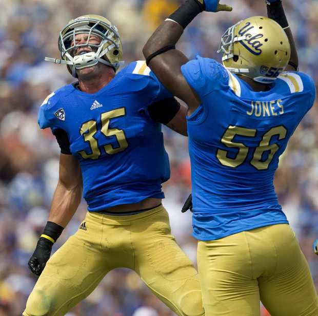 Bruins linebacker Jordan Zumwalt (35) and defensive end Datone Jones react after sacking Beavers quarterback Sean Mannion in the first half Saturday.