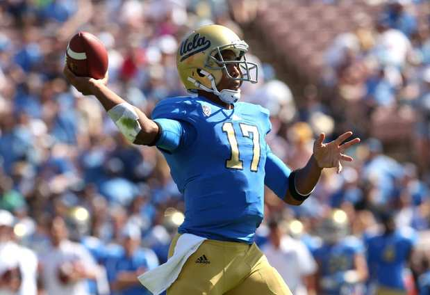 Bruins quarterback Brett Hundley finds a receiver during a pass play in the first half Saturday.