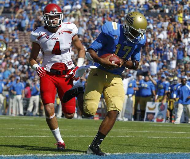 Bruins quarterback Brett Hundley beats Utes defensive back Brian Blechen to the goal line for a 12-yard touchdown run in the first half Saturday.