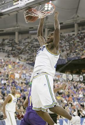 UCLA forward Luc Richard Mbah a Moute slams home the ball during a Bruin rally early in the second half.
