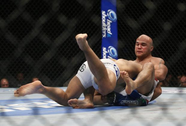 Robbie Lawler chokes out Josh Koscheck for a first-round victory in their welterweight bout at UFC 157 in Anaheim on Saturday night.