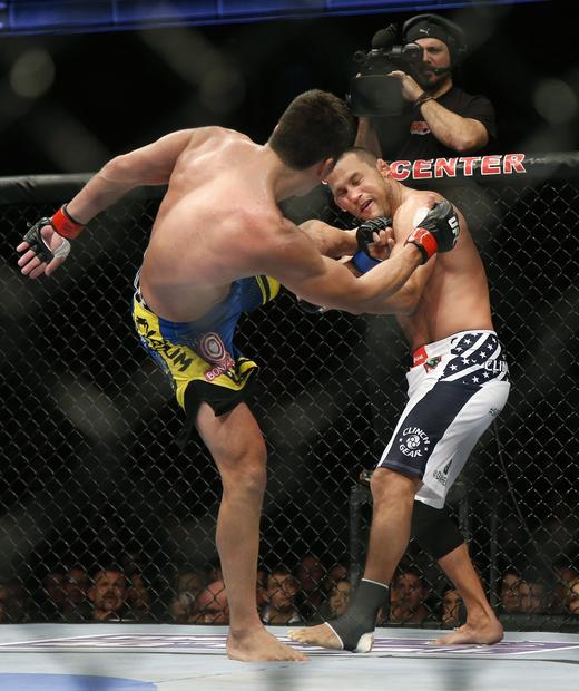 Lyoto Machida lands a kick against Dan Henderson in their light-heavyweight bout at UFC 157 on Saturday night at the Honda Center in Anaheim.