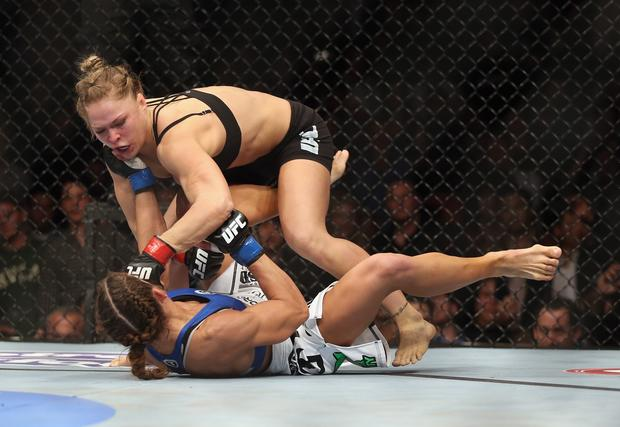 Ronda Rousey hits Liz Carmouche on her way to a first-round victory by submission Saturday night in Anaheim.