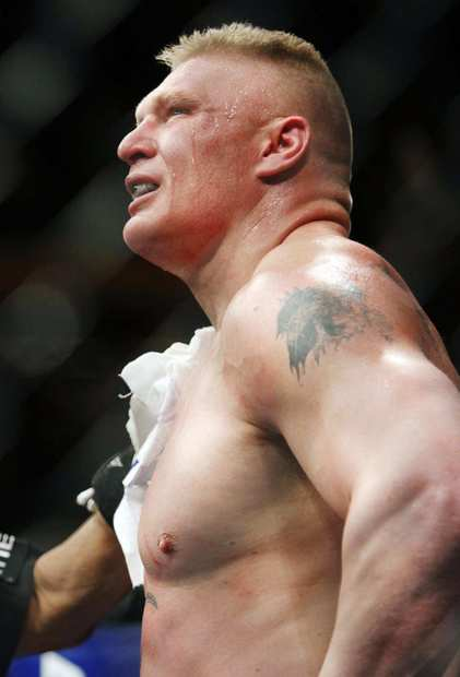 Brock Lesnar collects himself after losing to Alistair Overeem in the first round of their heavyweight fight on Friday night at UFC 141. Lesnar announced after the loss that he was retiring from mixed martial arts.