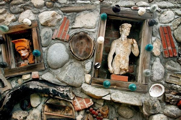 "The Zorthian Ranch has several ""art walls"" that contains objects and trinkets given to owner Jirayr Zorthian, usually as birthday gifts, which he cemented into walls."