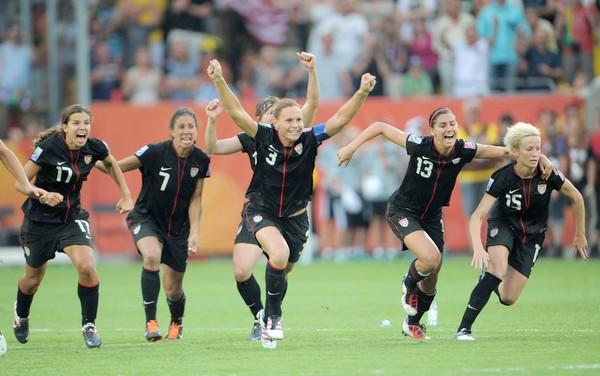 Americans Tobin Heath (17), Shannon Boxx (7), Christie Rampone (3), Alex Morgan (13) and Megan Rapinoe (15) celebrate after teammae Alex Krieger (not pictured) scored the winning goal on the final penalty kick to defeat Brazil in the Women's World Cup quarterfinal on Sunday.