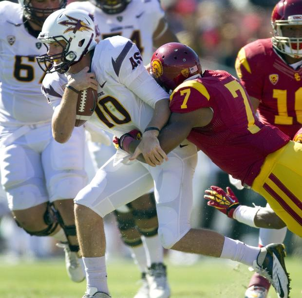 Trojans safety T.J. McDonald sacks Sun Devils quarterback Taylor Kelly in the first half Saturday.