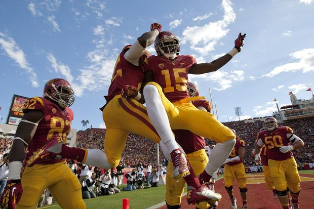 USC running back Curtis McNeal celebrates a 22-yard scoring reception with receiver Nelson Agholor (15) in the third quarter Saturday afternoon at the Coliseum.