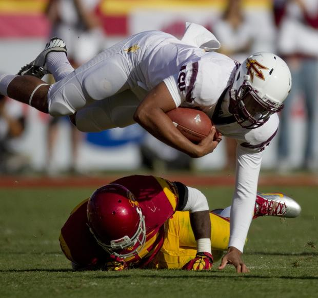 Trojans linebacker Lamar Dawson upends Sun Devils quarterback Michael Eubank in the second half Saturday.