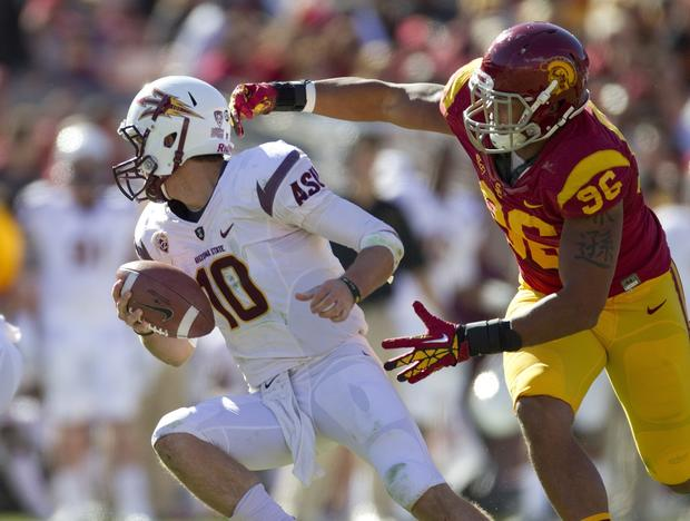 Arizona State quarterback Taylor Kelly tries to escape the grasp of USC defensive end Wes Horton in the first half Saturday.