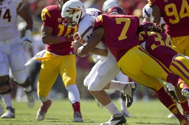 USC safety T.J. McDonald (7) helps linebacker Tony Burnett (34) bring down Arizona State quarterback Taylor Kelly in the first half Saturday.
