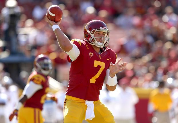 Trojans quarterback Matt Barkley passes against the Sun Devils in the first half Saturday at the Coliseum.