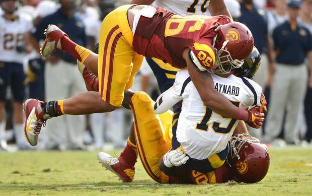 USC defensive end Wes Horton (96) and defensive tackle George Uko team up to sack California quarterback Zach Maynard in the second quarter Saturday.