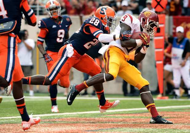 Trojans receiver Marqise Lee hauls in a touchdown catch against Syracuse safety Jeremi Wilkes in the second quarter.
