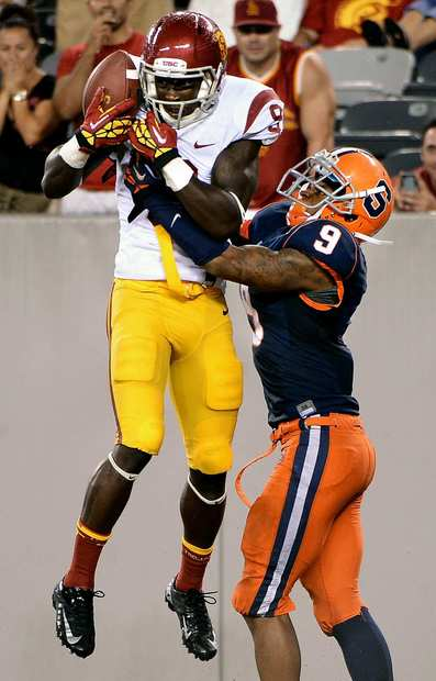 Trojans receiver Marqise Lee catches a touchdown pass over Syracuse cornerback Ri'Shard Anderson in the fourth quarter Saturday.