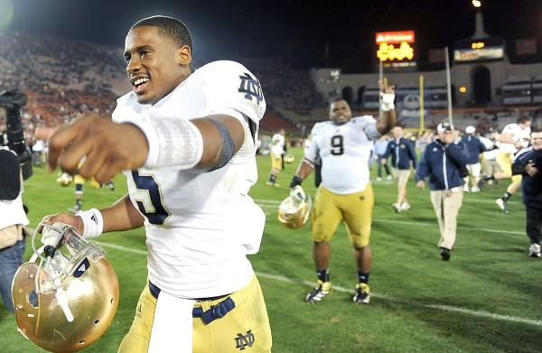 Notre Dame quarterback Everett Golson celebrates along with teammates after a 22-13 victory over USC on Saturday night at the Coliseum.