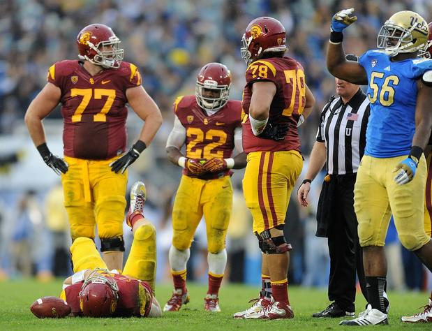 UCLA defensive tackle Datone Jones calls for the medical staff after USC quarterback Matt Barkley was injured on a sack in the fourth quarter Saturday.
