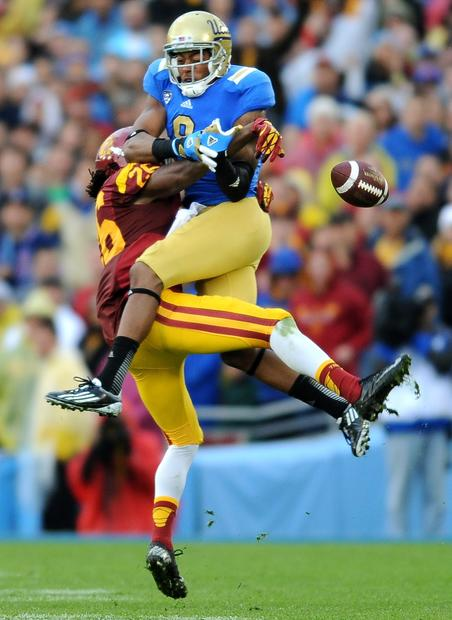 Trojans safety Josh Shaw deflects a pass intended for Bruins receiver Jerry Johnson at the Rose Bowl on Saturday.