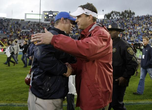 Coach Jim Mora of UCLA and Lane Kiffin of USC shake hands after the Bruins defeated the Trojans, 38-28, on Saturday afternoon.