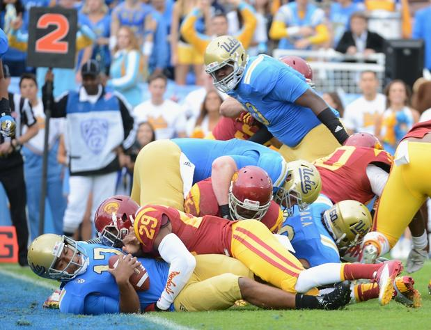 Bruins quarterback Brett Hundley scores the first touchdown of the game against the Trojans early in the first quarter Saturday.