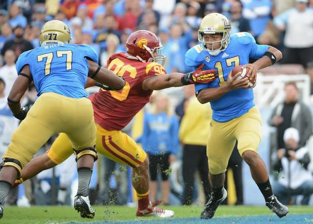 Bruins quarterback Brett Hundley tries to evade Trojans defensive end Wes Horton during a play in the first half Saturday.