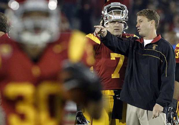 USC Coach Lane Kiffin talks to quarterback Matt Barkley as the Trojans prepare to play UCLA on Saturday night at the Coliseum.