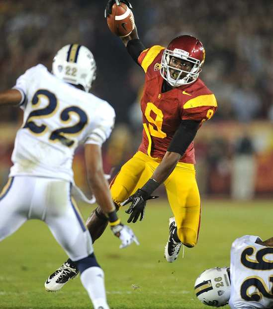 USC receiver Marqise Lee tries to keep his balance after a reception as he avoids a tackle attempt by a UCLA defender in the first quarter Saturday night at the Coliseum.