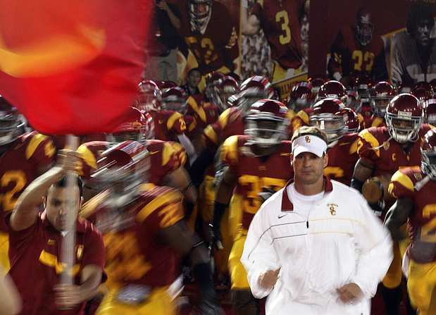 Coach Lane Kiffin and the Trojans take the field before their game against UCLA on Saturday night at the Coliseum.