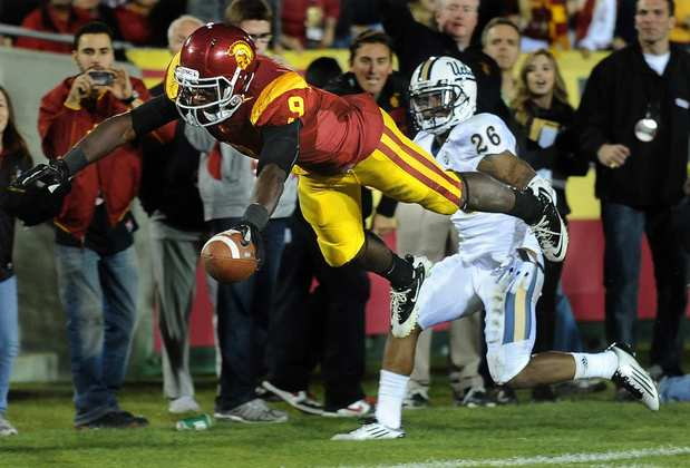 Trojans receiver Marqise Lee dives for the end zone but comes up short after a reception against Andrew Abbott and UCLA on Saturday night at the Coliseum