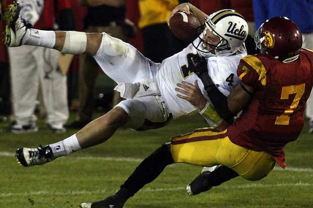 USC safety T.J. McDonald stops UCLA quarterback Kevin Prince from getting into the end zone in the fourth quarter Saturday night at the Coliseum.