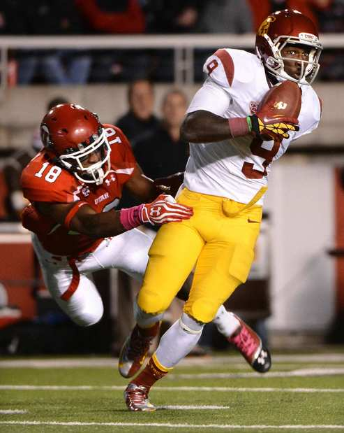 Trojans receiver Marqise Lee hangs onto the ball as Utes defensive back Eric Rowe fails to make the tackle on a scoring play in the fourth quarter Thursday night.