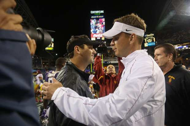 Coaches Steve Sarkisian of Washington and Lane Kiffin of USC greet each other after the Trojans' 24-14 victory on Saturday.