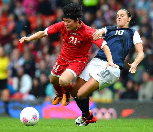 U.S. midfielder Carli Lloyd, right, gets physical with North Korea's Kim Su Gyong during the London 2012 Olympic Games.