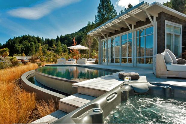The Jacuzzi and pool at the Matakauri Lodge. The lodge is the ideal jumping-off point for bungeeing from bridges, leaping off cliffs with a paragliding guide, zip-lining over forest canopies, whitewater rafting, fly fishing or hiking the Routeburn Track.